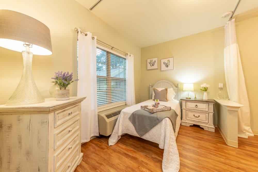 A bedroom at Cedar Crest Memory Care in Lafayette, Louisiana