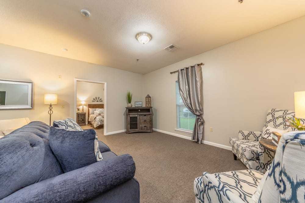 An open living room with a large window at Rosewood Assisted Living in Lafayette, Louisiana