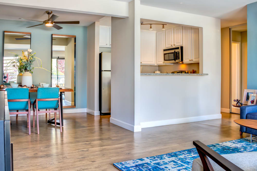 Luxurious hardwood floors in the open-concept living and dining areas of a model home at Sofi Berryessa in San Jose, California