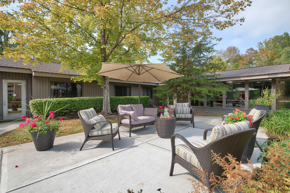 An outdoor patio with seating at The Country House in Westchester in Yorktown Heights, New York