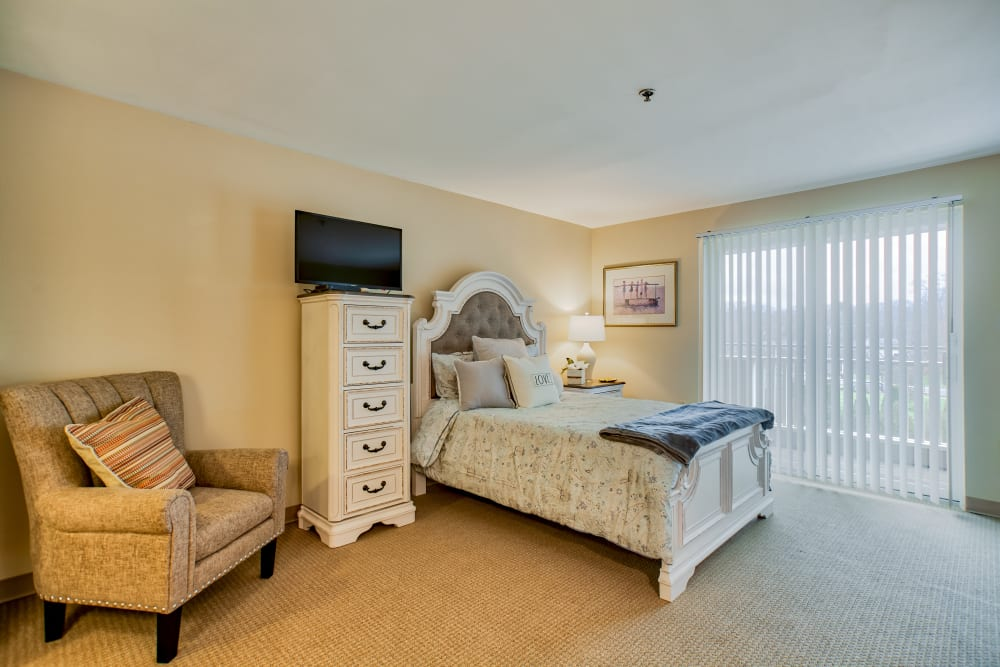 Spacious bedroom layout with private patio access at Chapel Hill in Cumberland, Rhode Island