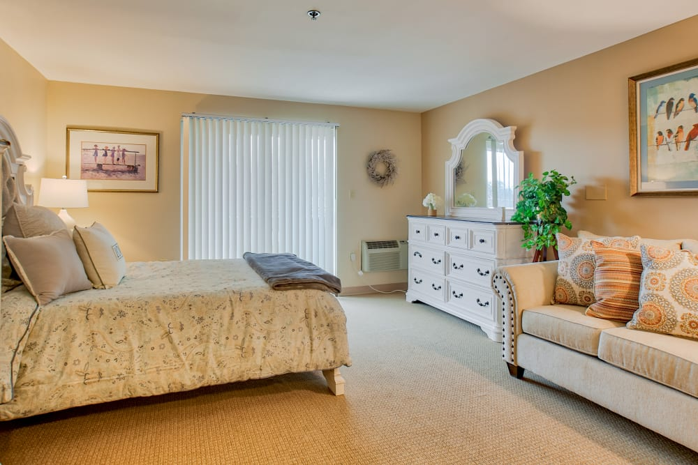 A spacious bedroom layout with room for a bed, a couch and a dresser at Chapel Hill in Cumberland, Rhode Island