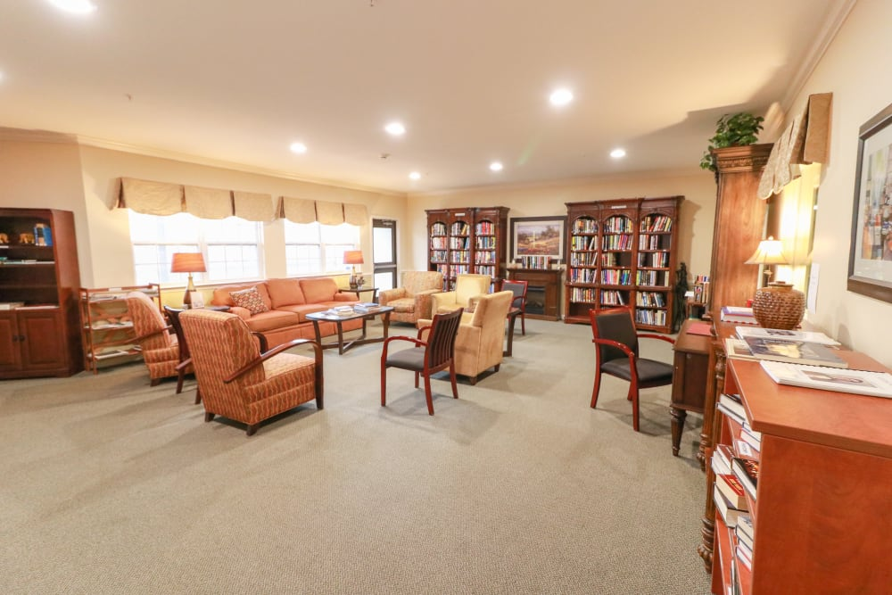 A spacious community area with fully stocked bookcases at The Crossings at Bon Air in Richmond, Virginia