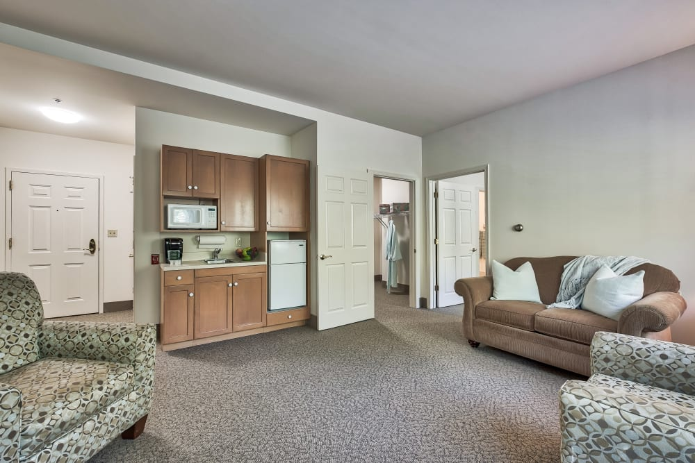 A living room and kitchenette at Hillhaven in Adelphi, Maryland