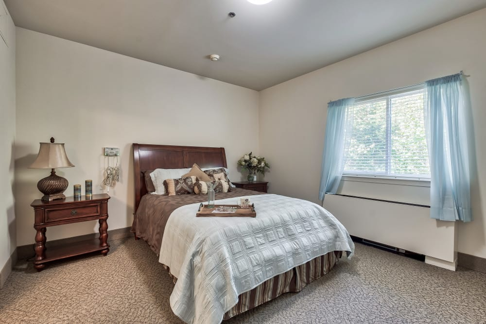A bedroom with a large window at Hillhaven in Adelphi, Maryland