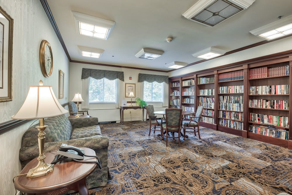 Multiple bookcases in a reading room at Hillhaven in Adelphi, Maryland