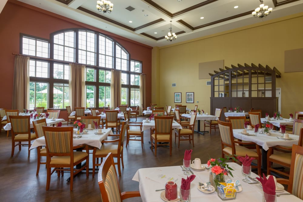 A sunlit dining area at The Reserve at East Longmeadow in East Longmeadow, Massachusetts