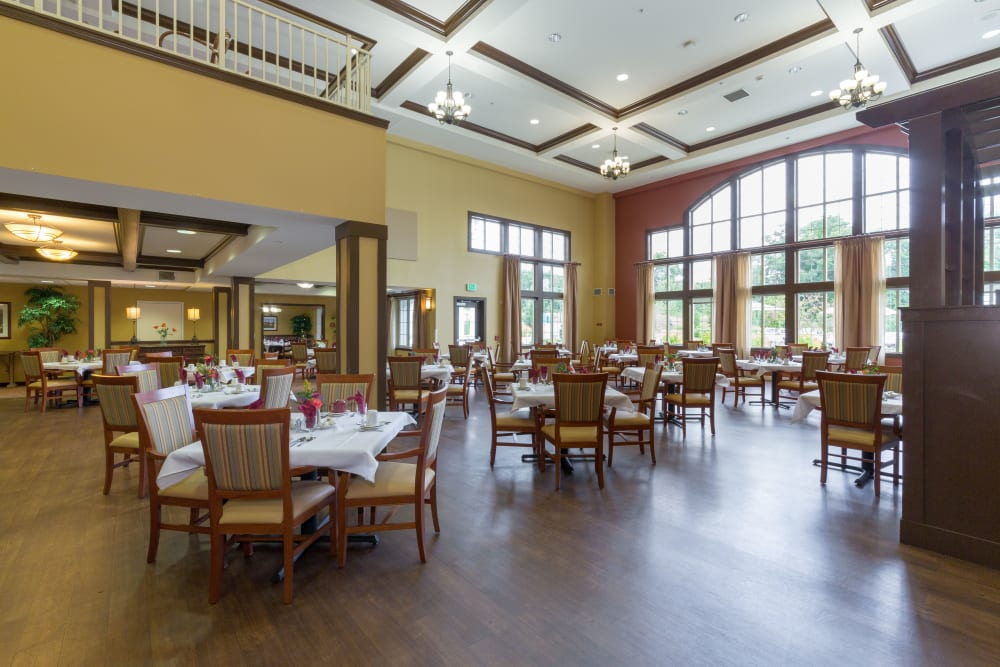 Sunshine coming through large windows into the dining area at The Reserve at East Longmeadow in East Longmeadow, Massachusetts