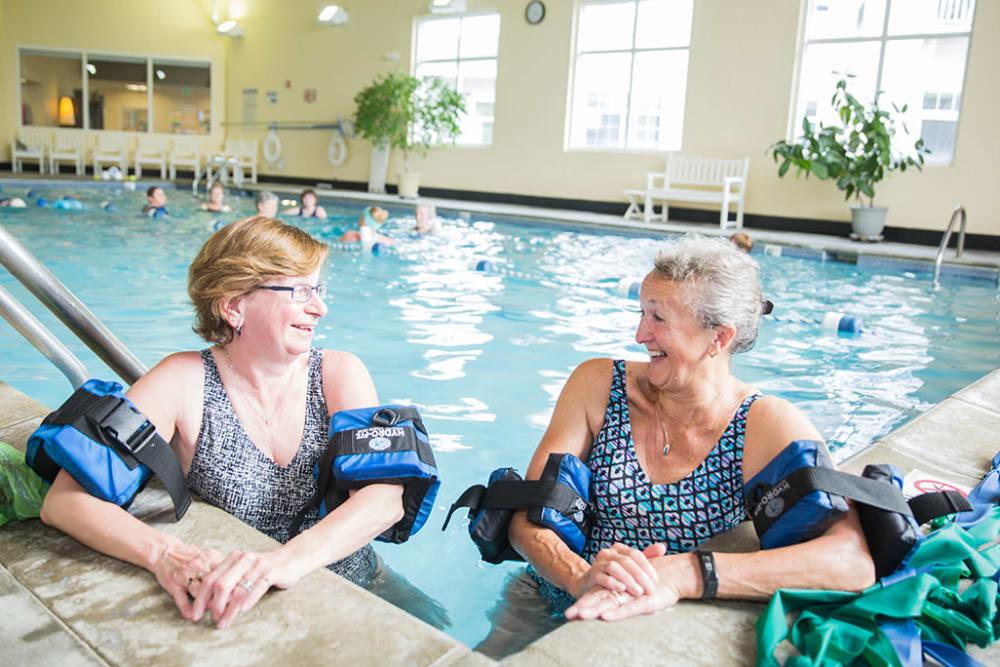 residents enjoying the indoor swimming pool