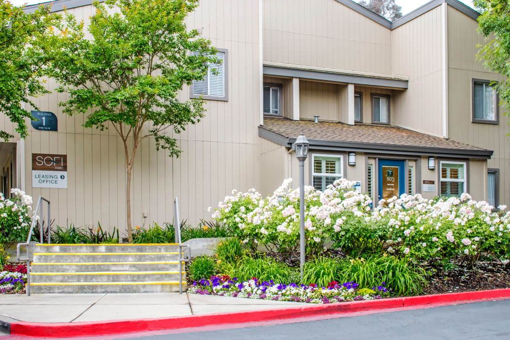 Exterior view of the leasing office with beautifully maintained landscaping at Sofi Dublin in Dublin, California