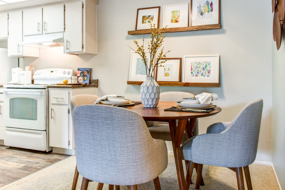 Dining area looking into the modern kitchen of a model home at Sofi Dublin in Dublin, California