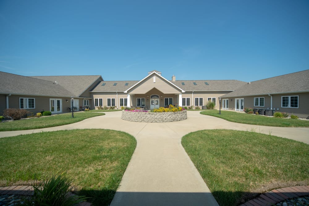 Wide-angle view of the central community courtyard at Villas of Holly Brook Herrin in Carterville, Illinois