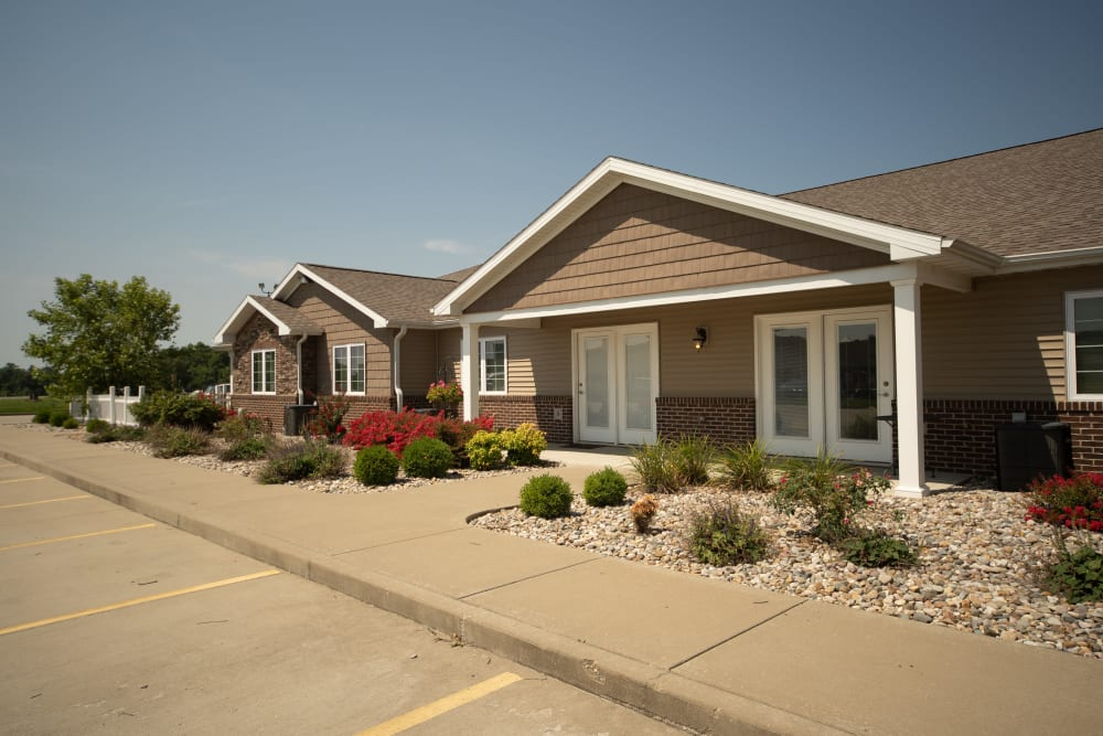 Parking in front of apartment entrances at Villas of Holly Brook Herrin in Carterville, Illinois