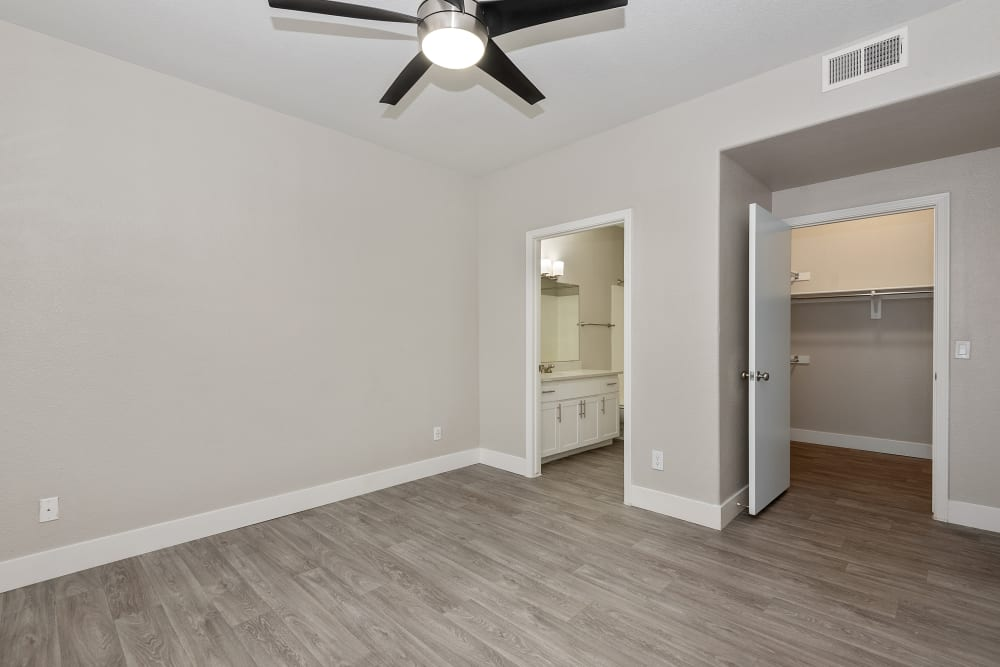 Bedroom with hardwood floor at The Retreat Apartments in Phoenix, AZ