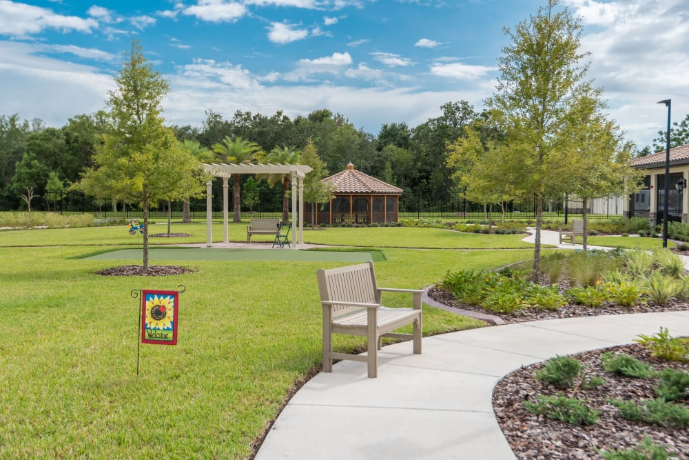 Courtyard with flowers and benches at Inspired Living Ocoee in Ocoee, Florida.