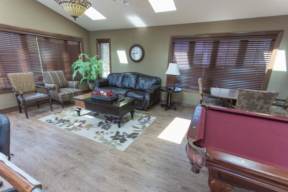Clubhouse with lots of seating and a pool table at Villas of Holly Brook Newton in Newton, Illinois
