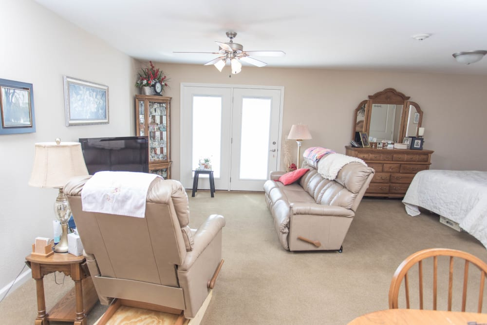 View of a furnished studio apartment at Villas of Holly Brook Newton in Newton, Illinois