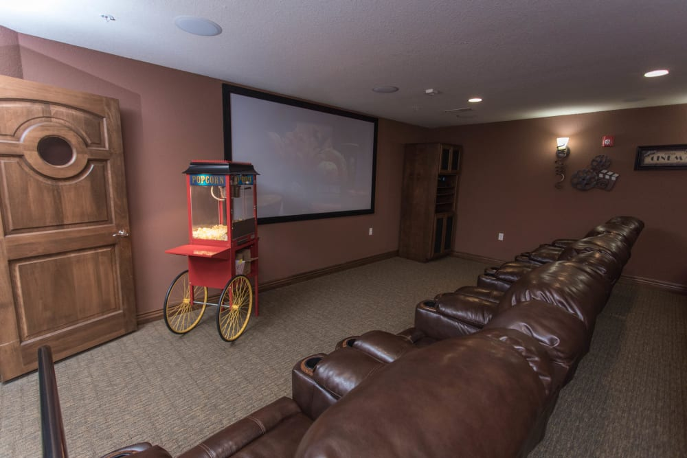 Onsite movie theater with a popcorn machine and 2 rows of seats at Villas of Holly Brook Shelbyville in Shelbyville, Illinois