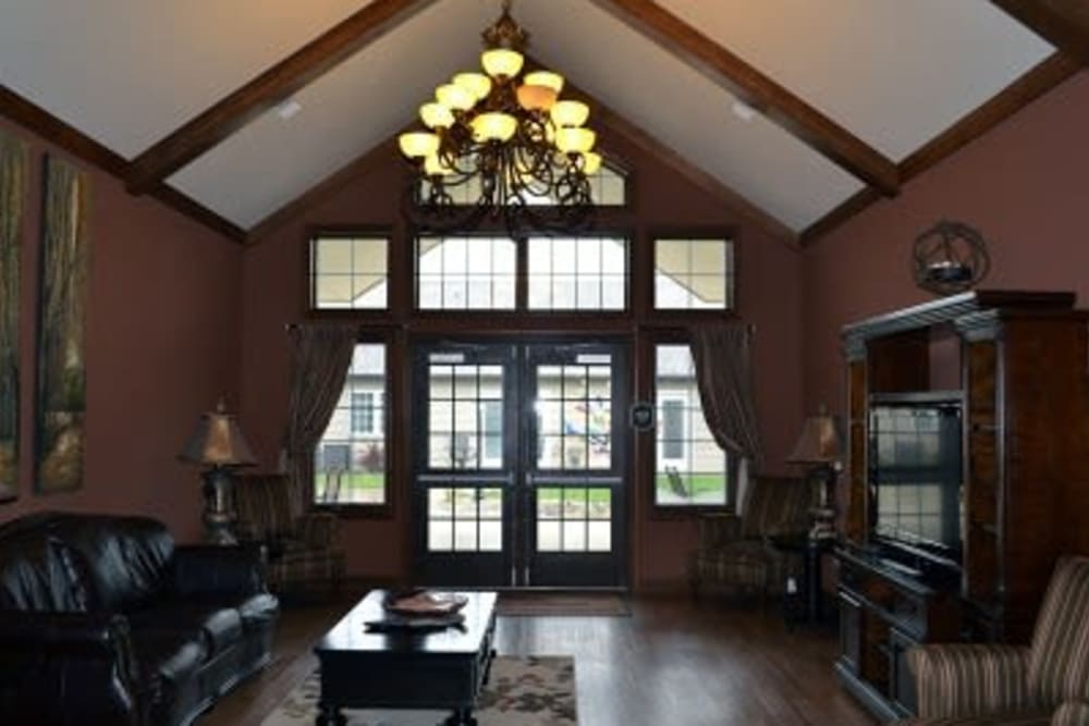 Community lounge with ample seating and a tv at Villas of Holly Brook Shelbyville in Shelbyville, Illinois