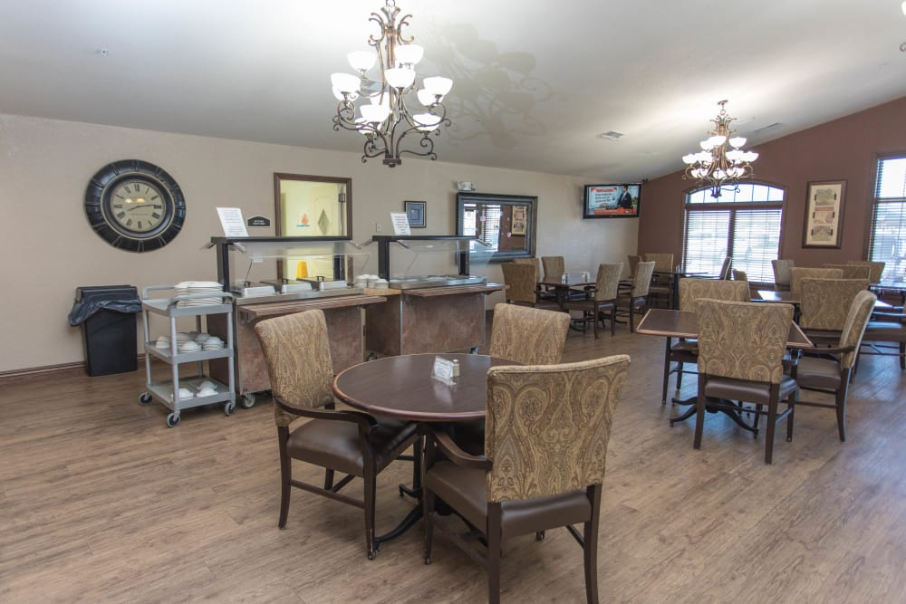 Dining hall with serving stations present at Villas of Holly Brook Shelbyville in Shelbyville, Illinois