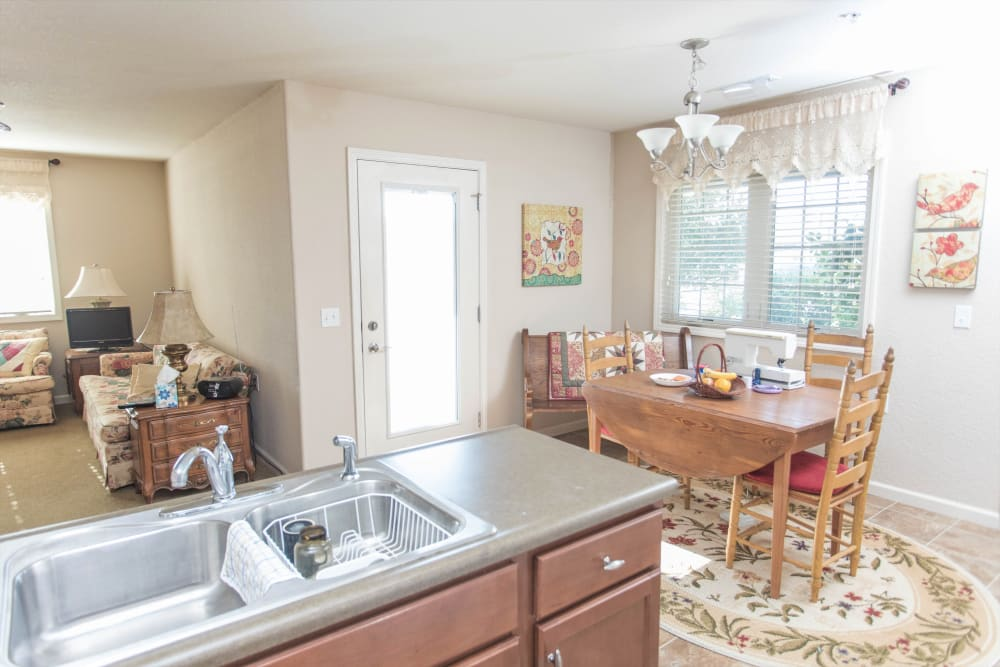 Senior apartment with a dining room and stainless steel appliances at Villas of Holly Brook Shelbyville in Shelbyville, Illinois