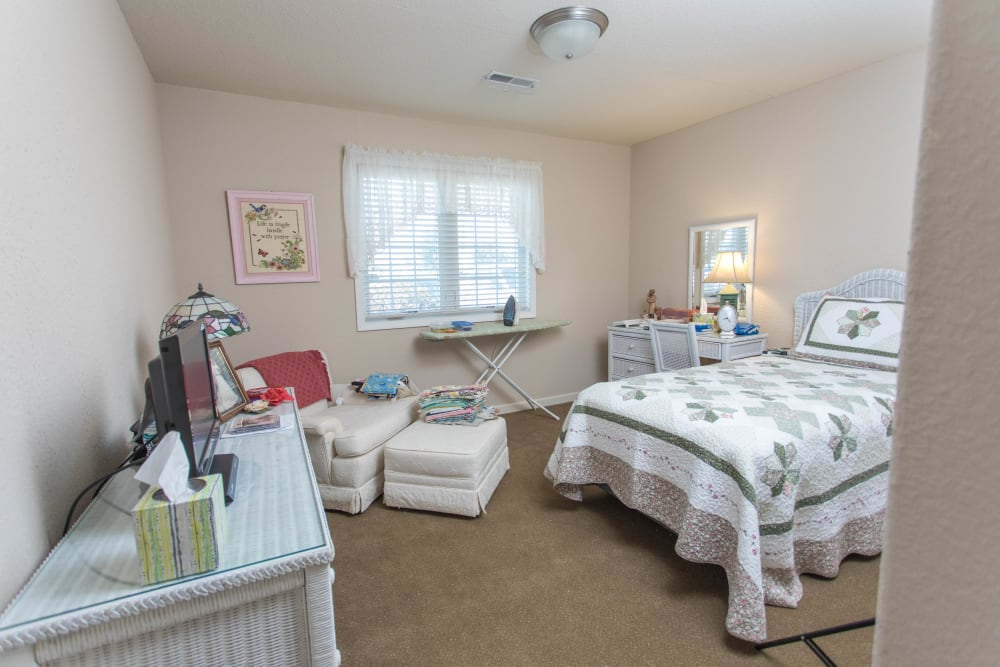 Single person bedroom at Villas of Holly Brook Shelbyville in Shelbyville, Illinois