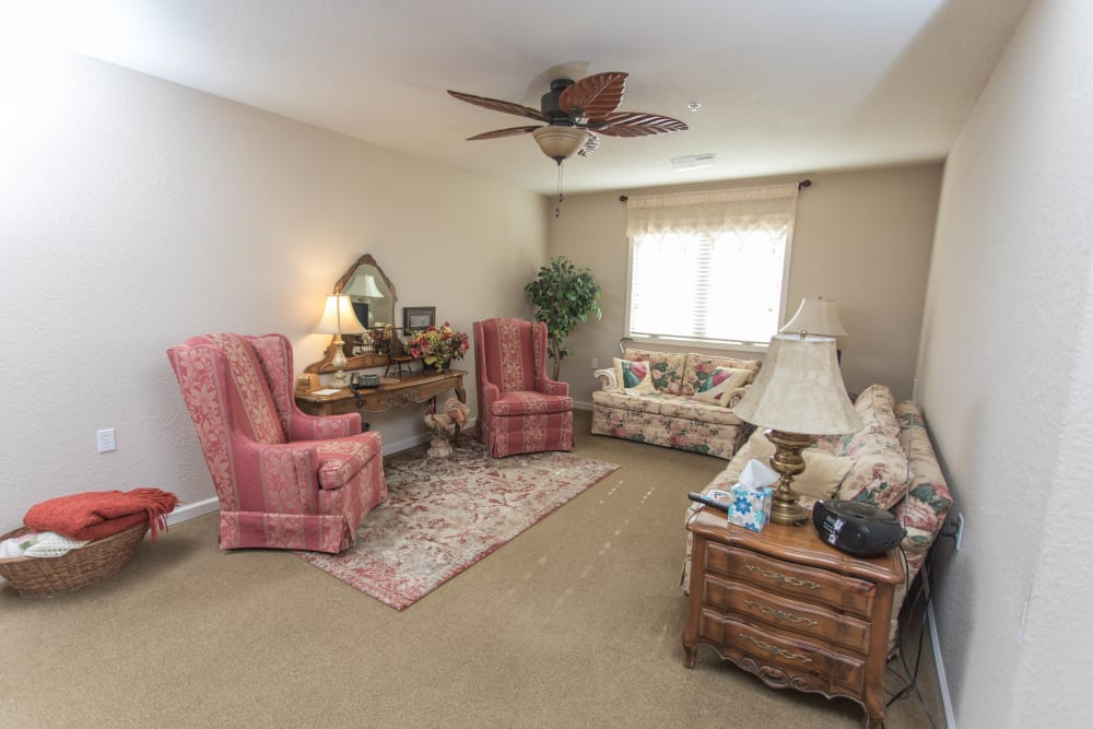 senior apartment living room with 2 chairs and 2 couches at Villas of Holly Brook Shelbyville in Shelbyville, Illinois