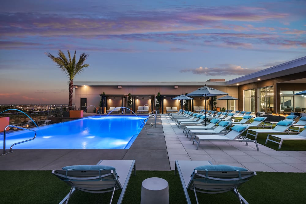 Beautiful swimming pool at sunset at The Halsten at Chauncey Lane in Scottsdale, Arizona