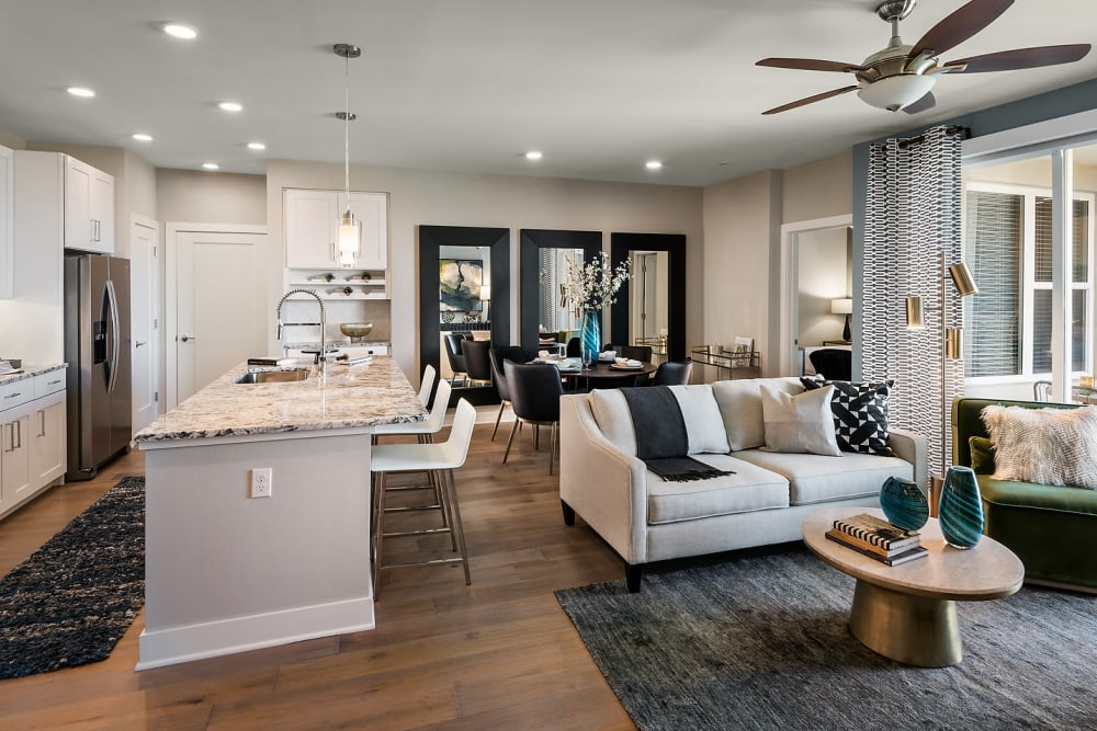 Beautiful open-concept floor plan with hardwood floors in a model home at The Halsten at Chauncey Lane in Scottsdale, Arizona