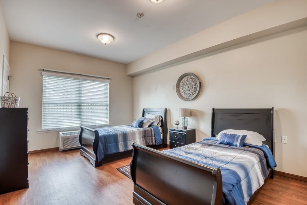 Bedroom for 2 residents with 2 twin beds at The Meadowlands in O'Fallon, Missouri