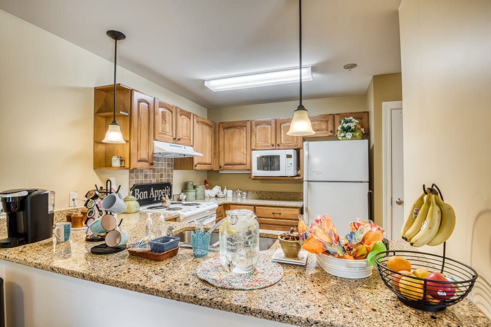 Community kitchen with a serving bar at The Meadowlands in O'Fallon, Missouri