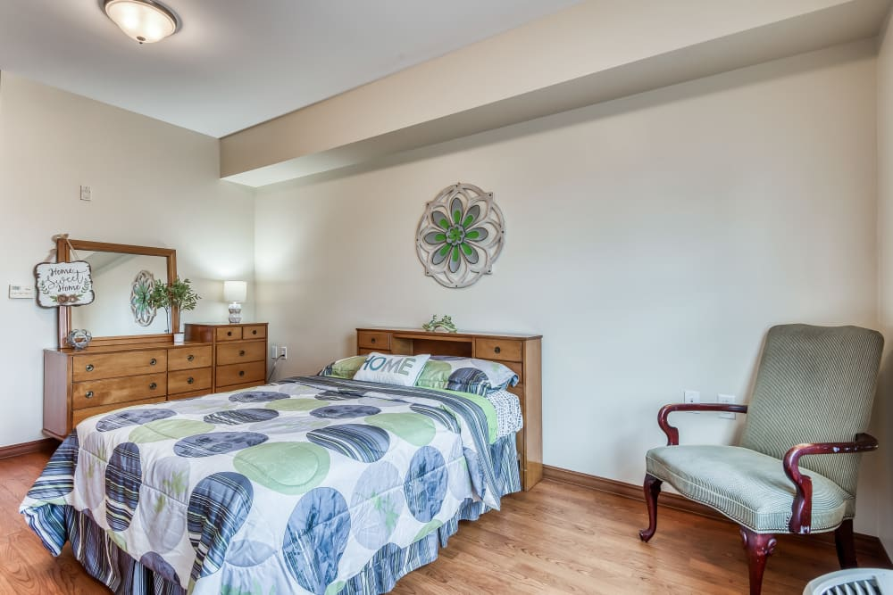 Private bedroom with a single bed and furniture at The Meadowlands in O'Fallon, Missouri
