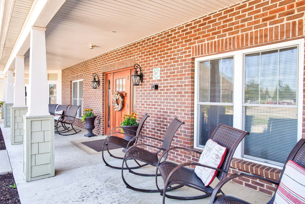 Front entrance with patio chairs at Landings of Huber Heights in Huber Heights, Ohio
