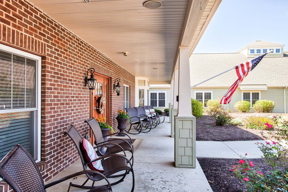 Patio with an American flag at Landings of Huber Heights in Huber Heights, Ohio
