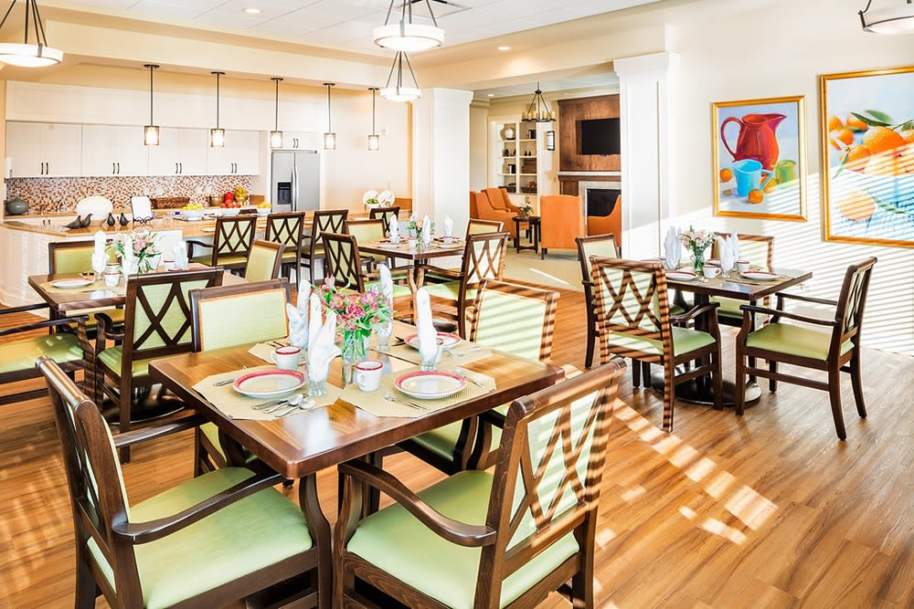 Set dining room tables at Azpira at Windermere in Windermere, Florida