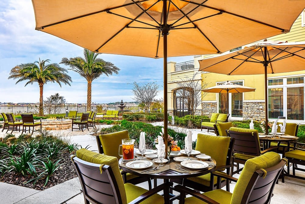Covered outdoor seating at Azpira at Windermere in Windermere, Florida