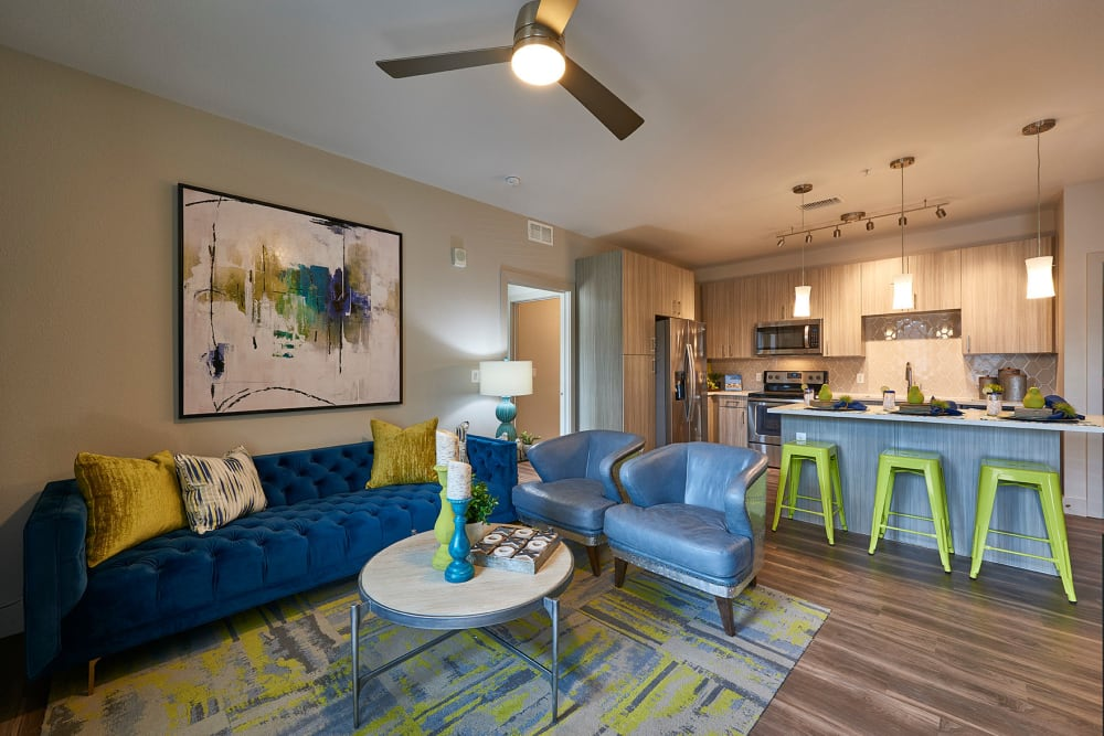 Spacious, bright living room at Encore Evans Station in Denver, Colorado