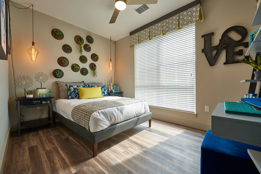 Cozy master bedroom at Encore Evans Station in Denver, Colorado