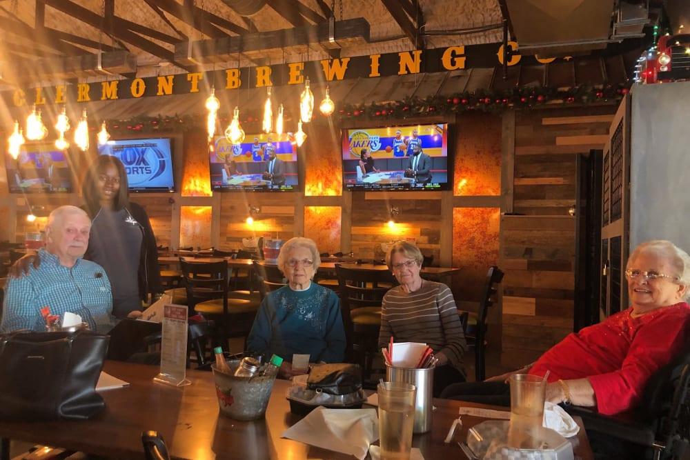 Residents in a restaurant near Inspired Living Ocoee in Ocoee, Florida