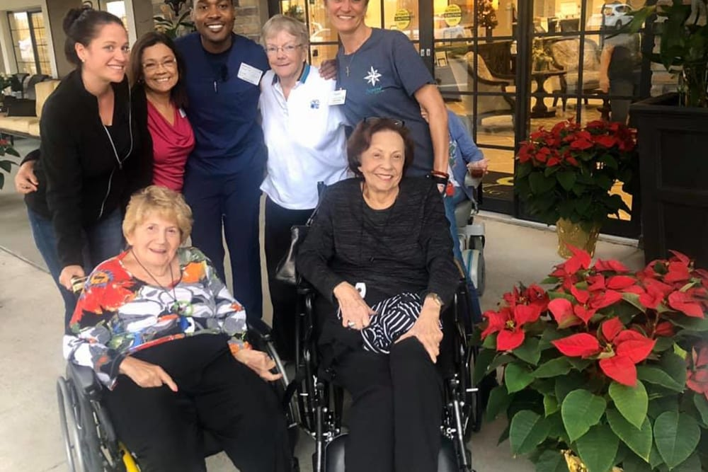 Residents and staff pose for a picture near Inspired Living Ocoee in Ocoee, Florida