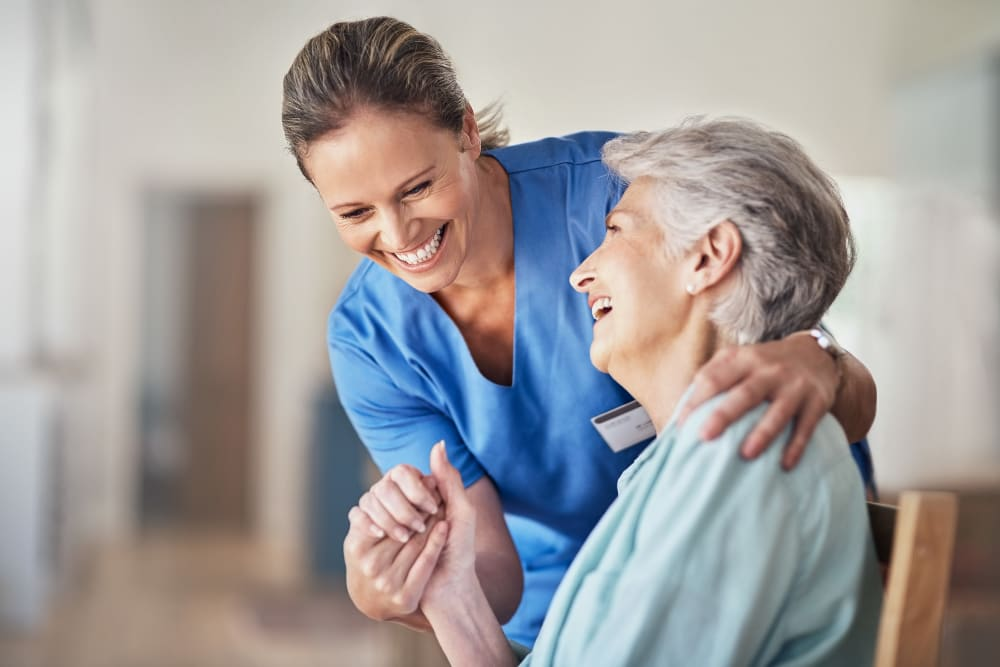 A resident with a caregiver at Western Slope Memory Care in Grand Junction, Colorado