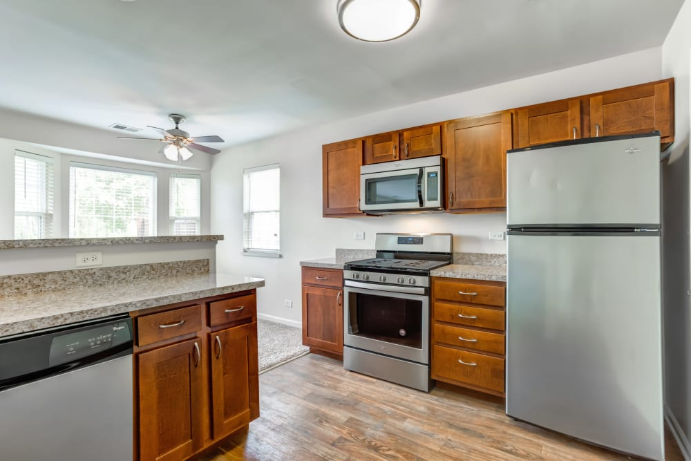 Kitchen with hardwood floor and brand new appliances at Lakeview Townhomes at Fox Valley in Aurora, Illinois