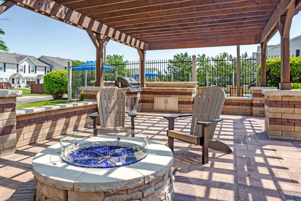 An outdoor fire pit at Lakeview Townhomes at Fox Valley in Aurora, Illinois