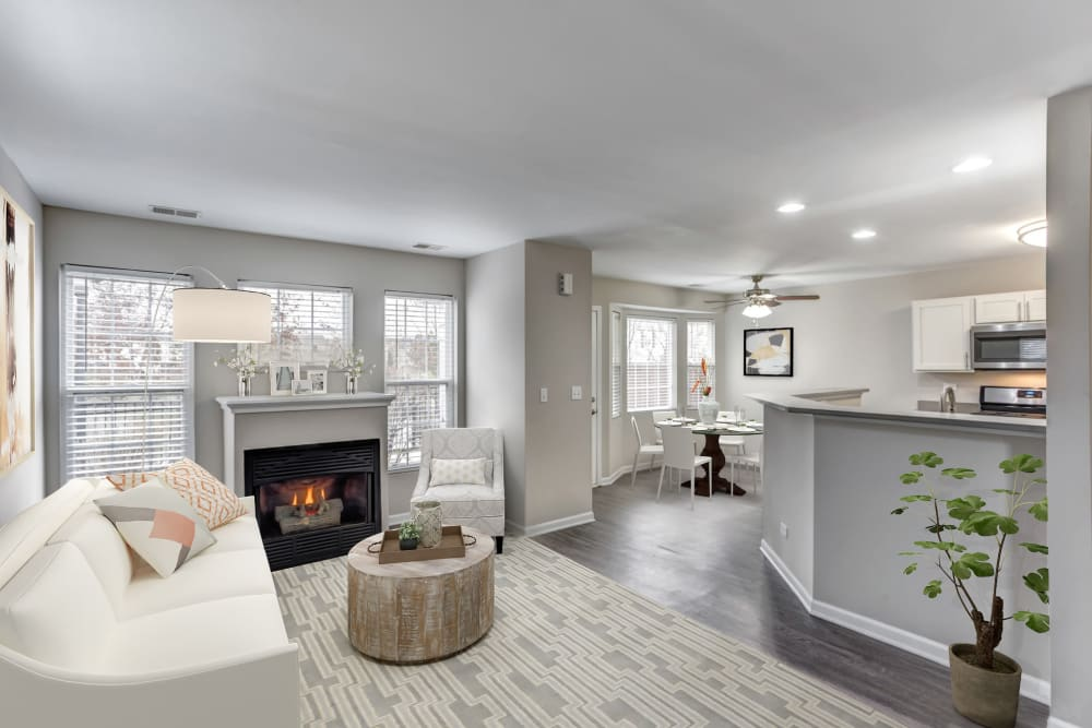 An apartment living room with fireplace at Lakeview Townhomes at Fox Valley in Aurora, Illinois