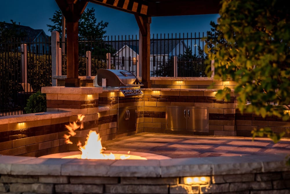 A patio with fire pit and bbq at Lakeview Townhomes at Fox Valley in Aurora, Illinois