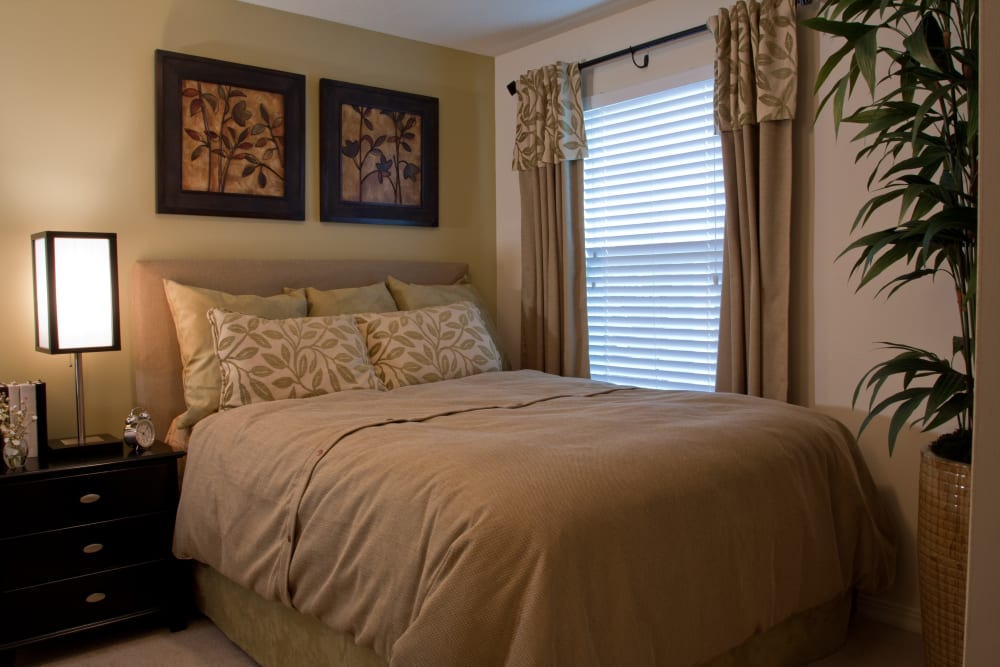 Well-furnished master bedroom in a model home at Abaco Key in Orlando, Florida