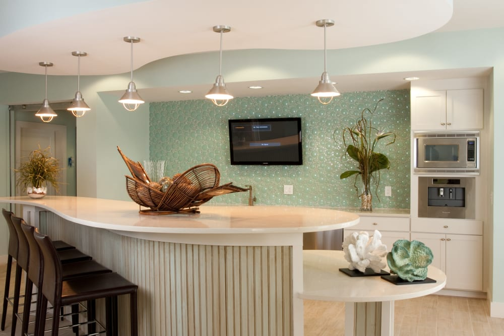 Resident clubhouse with a flatscreen TV at Abaco Key in Orlando, Florida