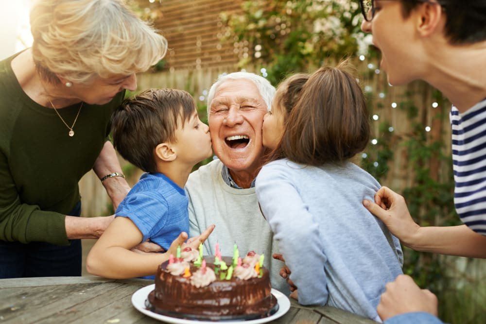 Resident celebrating their birthday with family at Bishop's Court in Allouez, Wisconsin