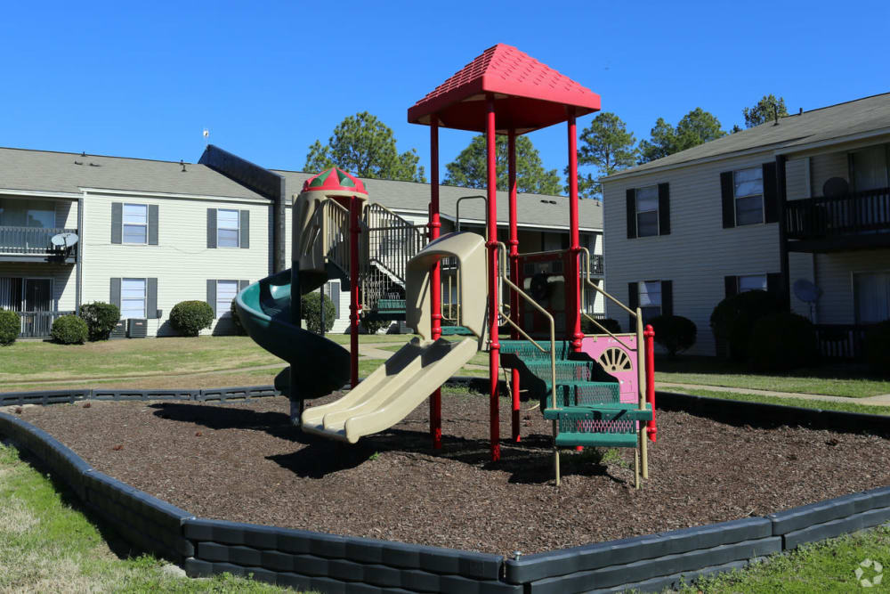 Playground outside at Pinebrook Apartments in Ridgeland, Mississippi