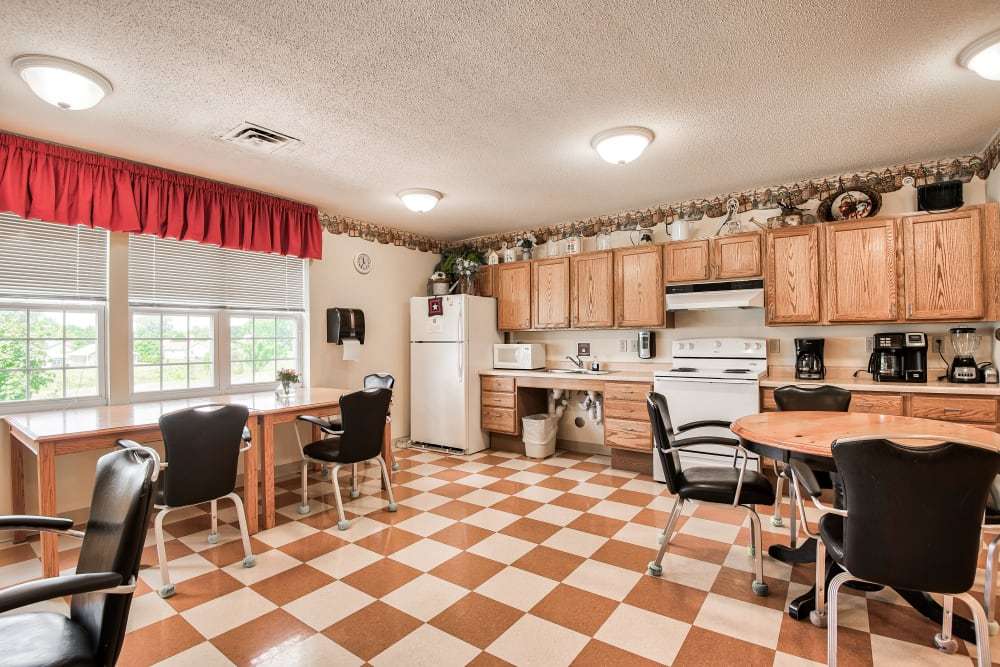 A dining area with checkered floors at Brookstone of Aledo in Aledo, Illinois